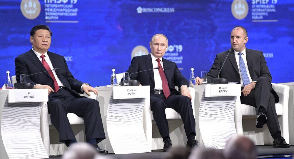 Russian President Vladimir Putin, Chinese President Xi Jinping and President of Bulgaria Rumen Radev on the SPIEF 2019