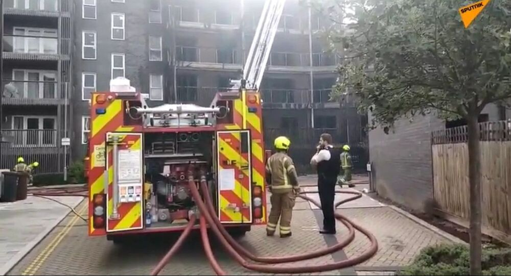 Dozens of firefighters were called to the scene on Sunday as a fire broke out at a new apartment block in the east of the British capital