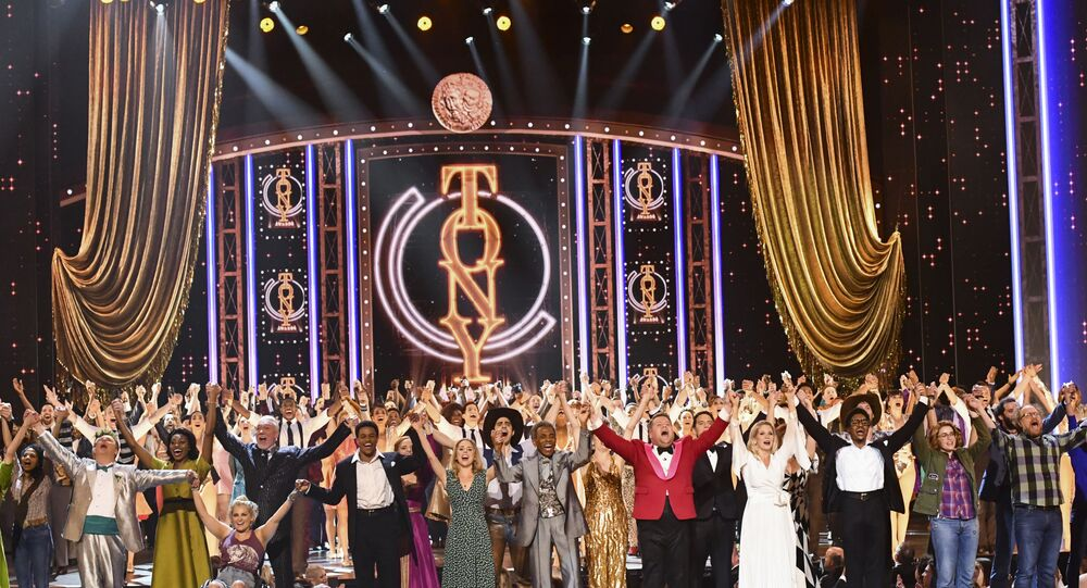 Host James Corden, fifth from right, is joined by cast of nominated musicals as he performs at the 73rd annual Tony Awards at Radio City Music Hall on Sunday, June 9, 2019, in New York. (Photo by Charles Sykes/Invision/AP)