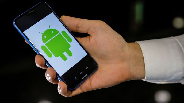 An Android logo is displayed on a Huawei smartphone in this illustration picture May 20, 2019 - Sputnik International