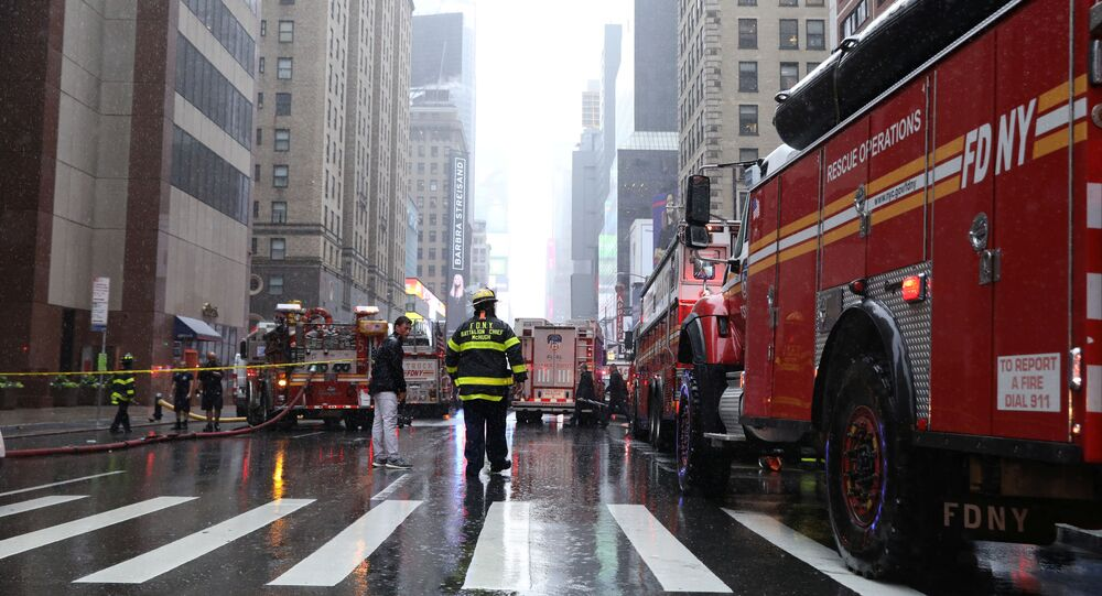 New York City Fire Department trucks and firefighters are seen outside 787 7th Avenue in midtown Manhattan where a helicopter was reported to have crashed in New York City, New York, U.S., June 10, 2019. REUTERS/Brendan McDermid