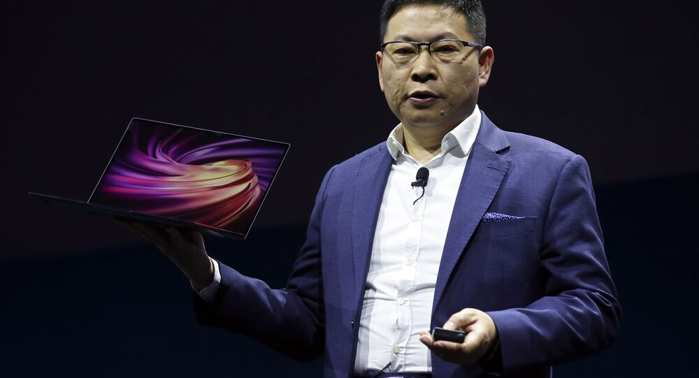 Huawei CEO Richard Yu displays a new HUAWEI MateBook X Pro laptop at the Mobile World Congress, in Barcelona, Spain, Sunday, Feb. 24, 2019