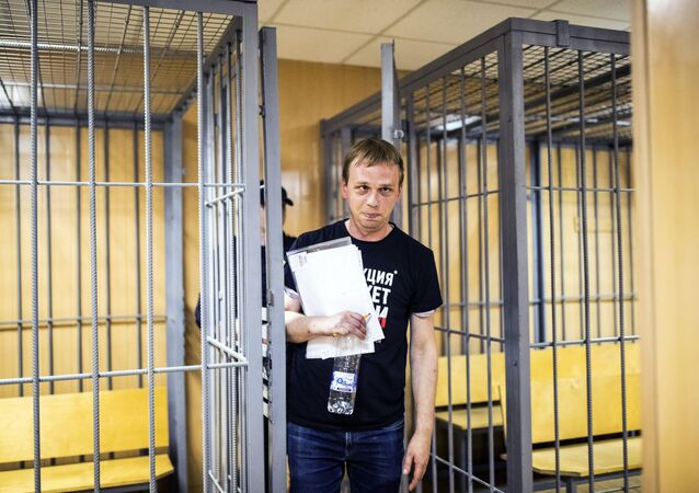 In this photo taken on Saturday, June 8, 2019, Ivan Golunov, a prominent Russian investigative reporter, who worked for the independent website Meduza, leaves the cage in a court room in Moscow, Russia. Golunov left the courtroom after the ruling to place him under house arrest until Aug. 7. In the court hearing, he denied being involved with drugs and said he would be willing to help investigators
