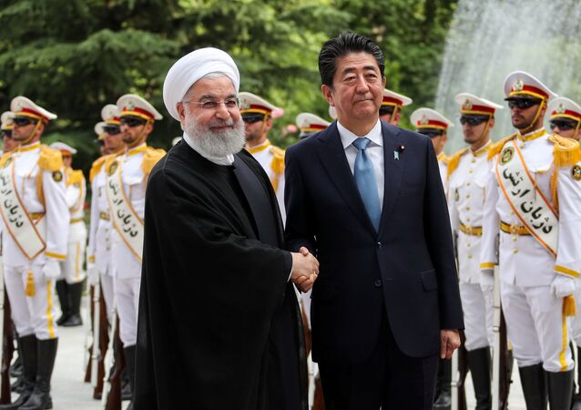 Iranian President Hassan Rouhani shakes hands with Japan's Prime Minister Shinzo Abe, during a welcome ceremony in Tehran, Iran, June 12, 2019. Official Iranian President website/Handout via REUTERS ATTENTION EDITORS - THIS IMAGE WAS PROVIDED BY A THIRD PARTY. NO RESALES. NO ARCHIVES