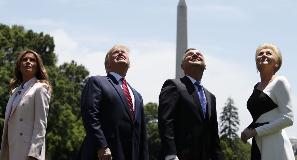 President Donald Trump, first lady Melania Trump, Polish President Andrzej Duda, and his wife Agata Kornhauser-Duda watch a flyover of two F-35 Joint Strike Fighter aircraft at the White House, Wednesday, June 12, 2019, in Washington.