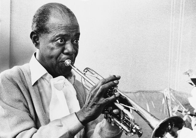 In a June 21, 1971 file photo jazz great Louis Armstrong  practices with his horn at his Corona, New York home on June 21, 1971. A live recording of Louis Armstrong playing his trumpet for one of the last times is being played Friday April 27, 2012 at the National Press Club in Washington where it was created in January 1971.  (AP Photo/Eddie Adams, file)