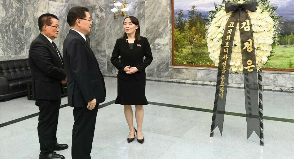 North Korean leader Kim Jong Un's sister, Kim Yo Jong, a senior official of North Korea's ruling party, center, speaks to South Korean presidential national security director Chung Eui-yong, second from left, and a lawmaker Park Ji-won, left, near the condolence flowers for former South Korean first lady Lee Hee-ho at the northern side of the border village of Panmunjom in the Demilitarized Zone, South Korea, Wednesday, June 12, 2019