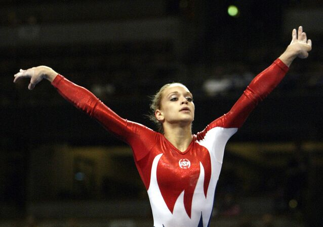 Terin Humphrey of Blue Springs, Mo., competes in the floor exercise during a preliminary round of the U.S. Olympic gymnastics team trials in Anaheim, Calif., Friday, June 25, 2004