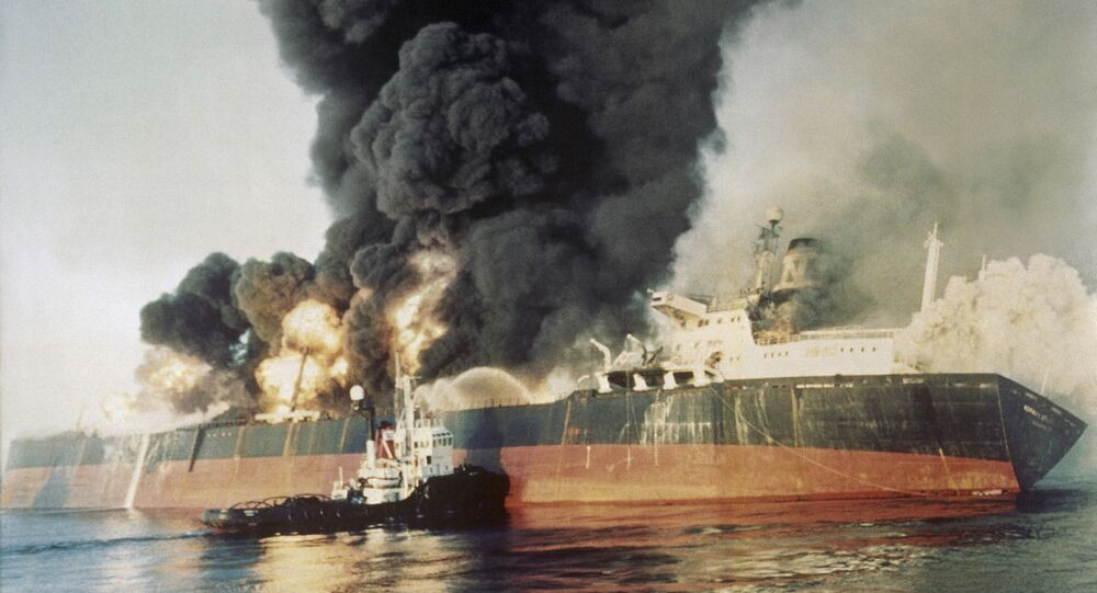 The Singapore registered tanker Norman Atlantic sits ablaze in the Straits of Hormuz on Dec. 6, 1987, after being attacked by an Iranian gunboat. The 86,129 ton tanker was carrying a cargo of naphtha liquid gas from Kuwait. All 22 crewmen left the ship and no injuries were reported.