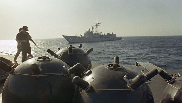 Mines aboard the ship Iran Ajr are inspected by a boarding party from the USS LaSalle in the Persian Gulf, Sept. 1987. The USS Jarett waits in the background. The two American boats were among those escorting U.S.-flagged Kuwaiti oil tankers through the Gulf in the face of the continuing Iran-Iraq War.  - Sputnik International