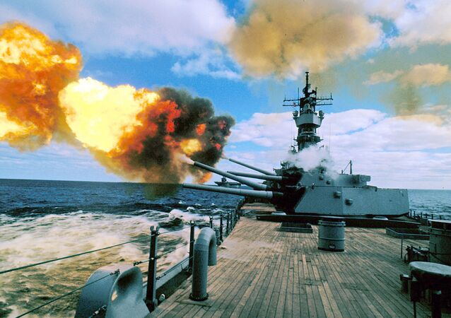 In this Dec. 16, 1987 file photo, the battleship USS Iowa fires its 16-inch guns during duty in the Persian Gulf.