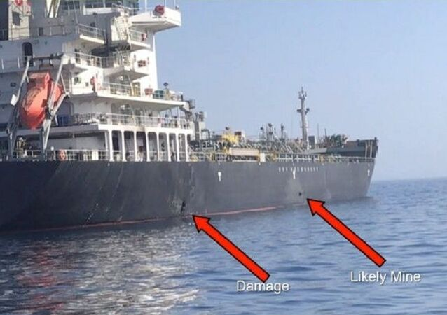 A picture released by U.S. Central Command shows damage from an explosion (L) and a likely limpet mine, on the hull of the civilian vessel M/V Kokuka Courageous in the Gulf of Oman in the Arabian Sea, in waters between Gulf Arab states and Iran, June 13, 2019