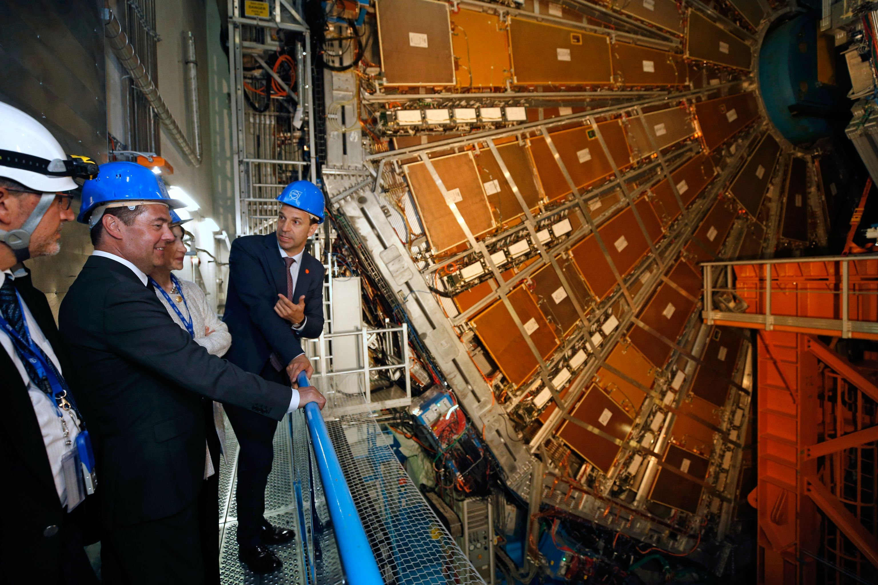Russian Prime Minister Dmitri Medvedev watches the ATLAS particle detector, constructed at the Large Hadron Collider, as he tours CERN in Geneva, Switzerland. First Deputy Minister of Science and Higher Education Grigory Trubnikov, right.