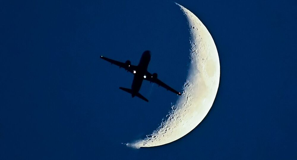Airbus A320 aircraft flying in front of the Moon.