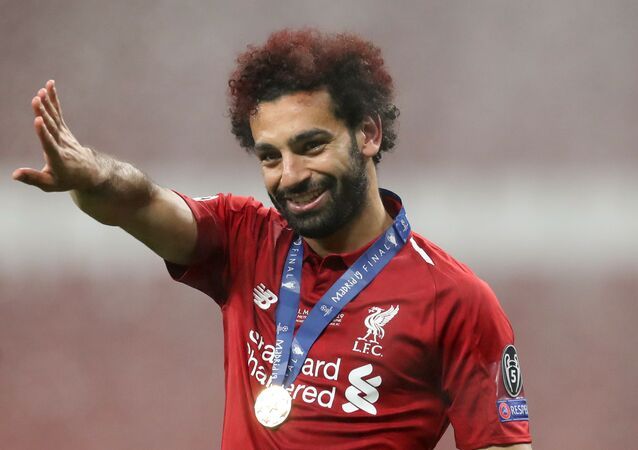 Soccer Football - Champions League Final - Tottenham Hotspur v Liverpool - Wanda Metropolitano, Madrid, Spain - June 1, 2019 Liverpool's Mohamed Salah celebrates after winning the Champions League Final
