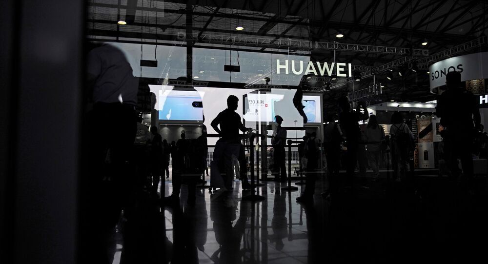 A Huawei company logo is seen at CES (Consumer Electronics Show) Asia 2019 in Shanghai, China June 11, 2019