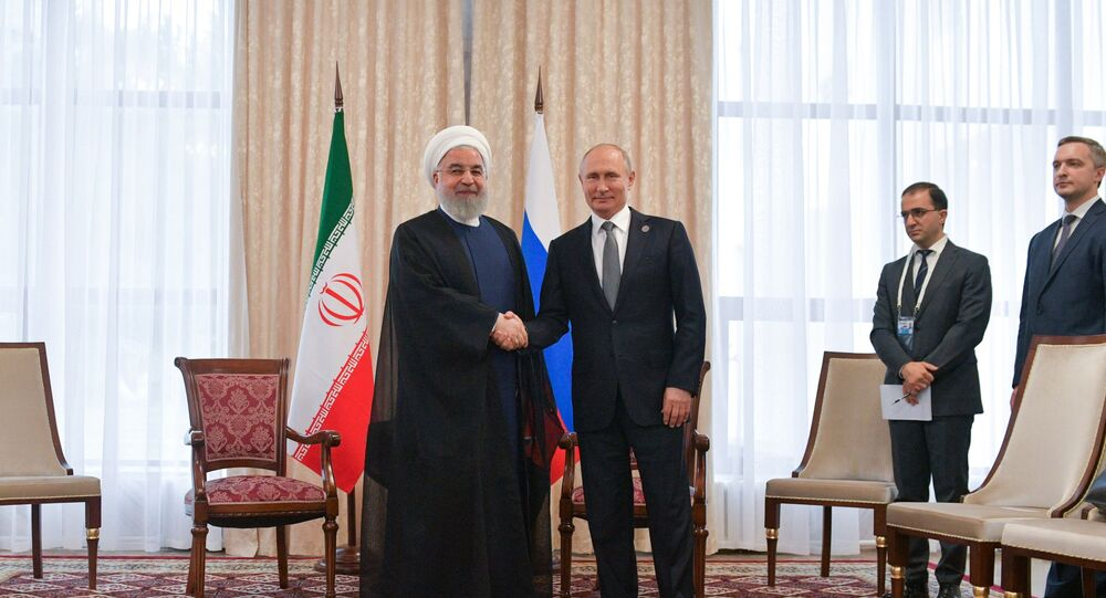 Russian President Vladimir Putin shakes hands with Iranian President Hassan Rouhani, left, during their meeting at the Shanghai Cooperation Organization (SCO) summit, in Bishkek, Kyrgyzstan