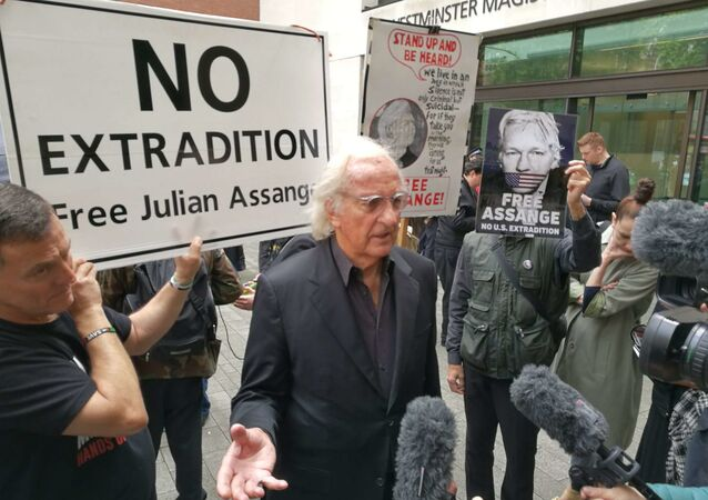 BAFTA award-winning documentary film maker John Pilger at protests in London against WikiLeaks' founder's Julian Assange's extradition