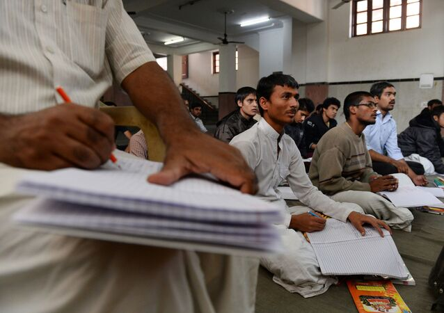 Indian participants attend a Sanskrit class at the Sanskrit Samvadshala on the outskirts of New Delhi (File)