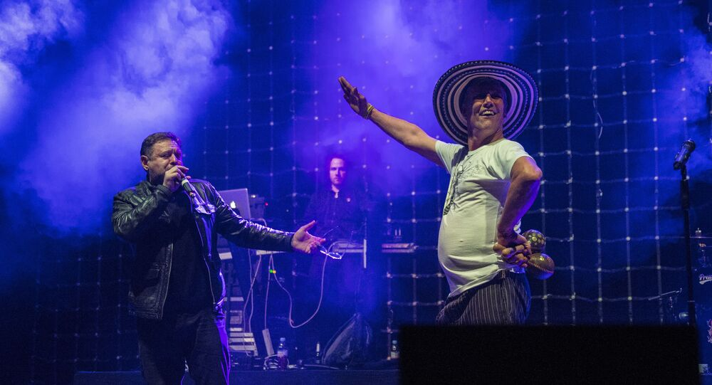 Shaun Ryder, left, and Bez, of British band Happy Mondays, perform on stage at the Brixton Academy in south London, Thursday, Dec. 3, 2015. Happy Mondays are on tour to celebrate the 25th anniversary of their album Pills 'n' Thrills and Bellyaches