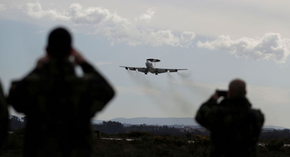 A NATO AWACS (Airborne Warning and Control Systems) aircraft approaches the Air Base number 5