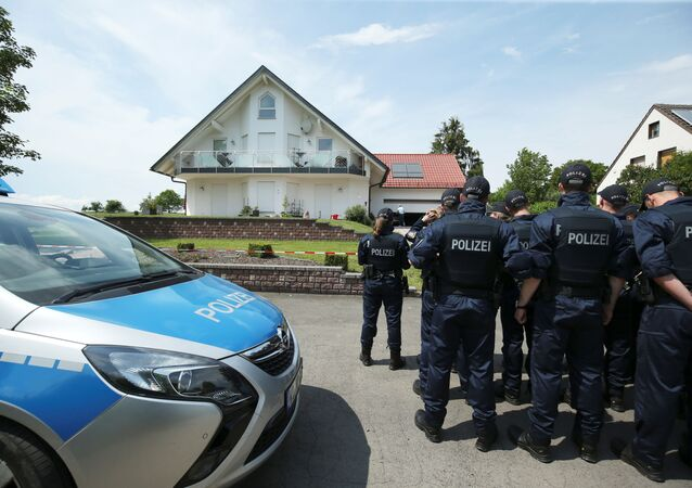 German police officers arrive at the house of District President of Kassel Walter Luebcke, who was found dead, to search neighbouring properties in Wolfhagen-Istha near Kassel, Germany, June 3, 2019.   REUTERS/Ralph Orlowski