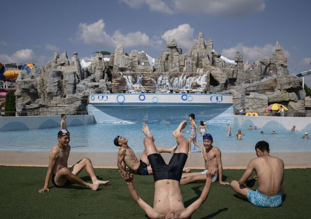 In a photo taken on June 16, 2019 swimmers rest beside a wave pool at the Munsu water park in Pyongyang.