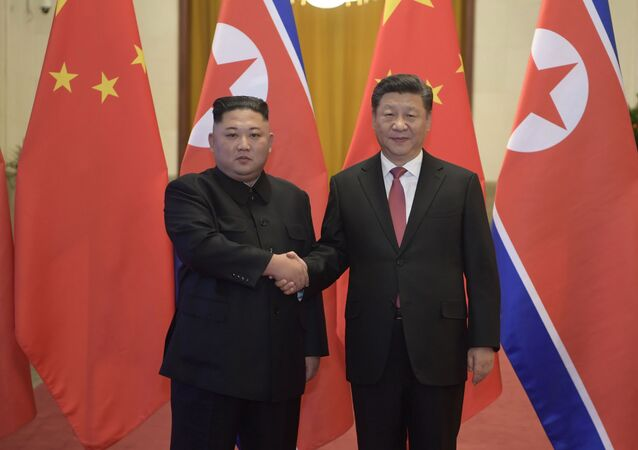 In this Tuesday, Jan. 8, 2019, photo released by China's Xinhua News Agency, North Korean leader Kim Jong Un, left, and Chinese President Xi Jinping shake hands as they pose for a photo before talks at the Great Hall of the People in Beijing
