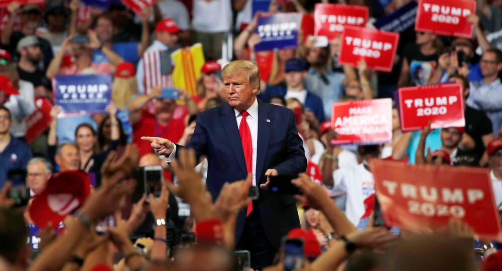 U.S. President Donald Trump reacts with supporters formally kicking off his re-election bid with a campaign rally in Orlando, Florida, U.S., June 18, 2019