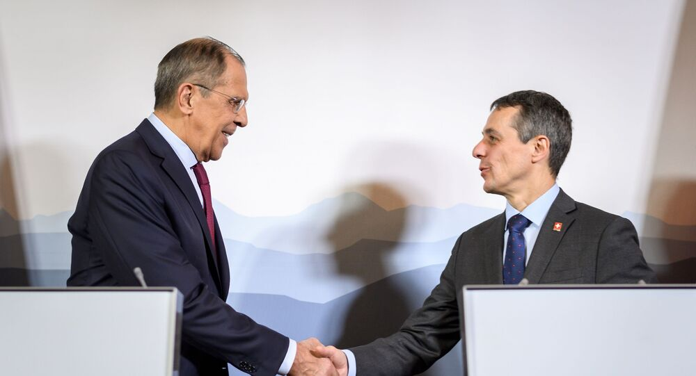 Russian Foreign Minister Sergei Lavrov (L) shakes hands with Swiss Foreign Minister Ignazio Cassis