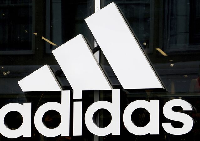 The logo of the sports goods manufacturer 'adidas' is pictured in Berlin, Germany, Monday, May 6, 2019