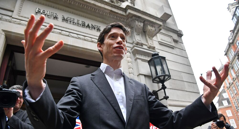 Britain's International Development Secretary Rory Stewart, a contender for the Conservative Party leadership, addresses members of the media as he leave the Millbank televsions studios in London on June 19, 2019