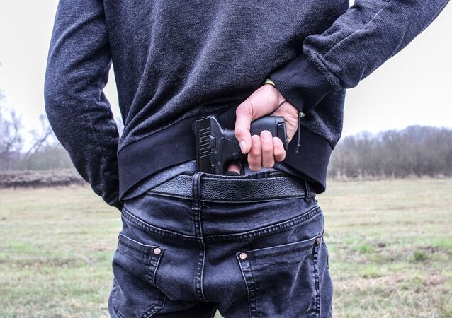 Man pulls handgun from waistband