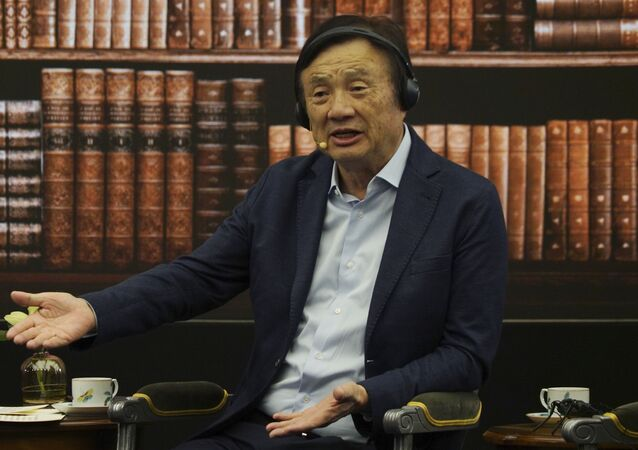 Huawei founder Ren Zhengfei speaks during a roundtable at the telecom giant's headquarters in Shenzhen