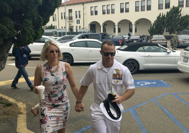 Navy Special Operations Chief Edward Gallagher, right, walks with his wife, Andrea Gallagher, as they arrive to military court on Naval Base San Diego, Thursday, June 20, 2019, in San Diego.