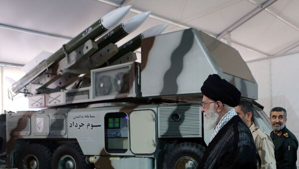 Iran's Supreme Leader Ayatollah Ali Khamenei is seen near a 3 Khordad system which is said to had been used to shoot down a U.S. military drone - Sputnik International