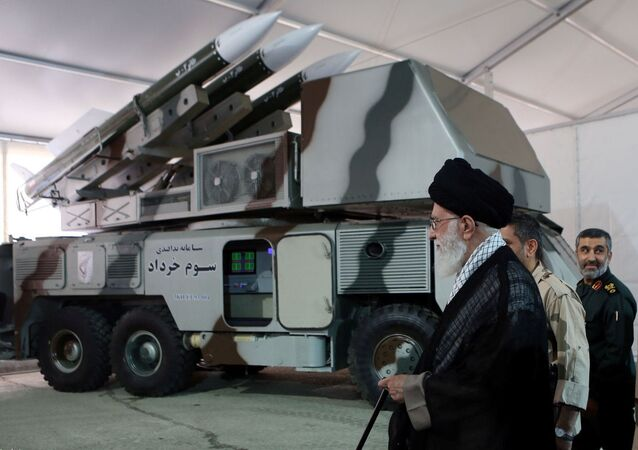 Iran's Supreme Leader Ayatollah Ali Khamenei is seen near a 3 Khordad system which is said to had been used to shoot down a U.S. military drone