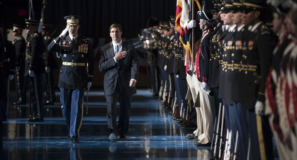 Mark Esper, right, during the troop inspection at Conmy Hall