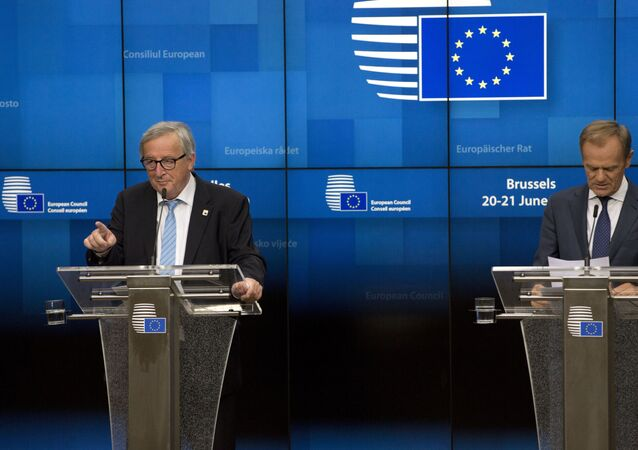 European Commission President Jean-Claude Juncker, left, and European Council President Donald Tusk participate in a media conference at an EU summit in Brussels