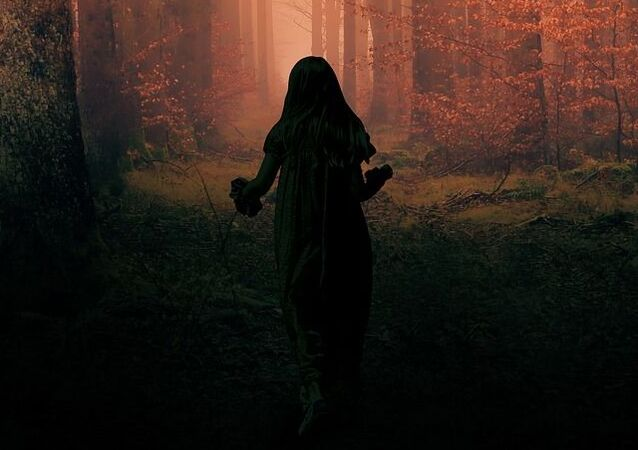 Scary Kid in Dark Night Forest
