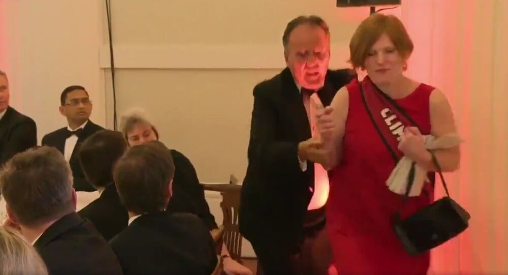 Footage shows foreign office minister Mark Field MP removing a protestor from the Mansion House dinner earlier this evening