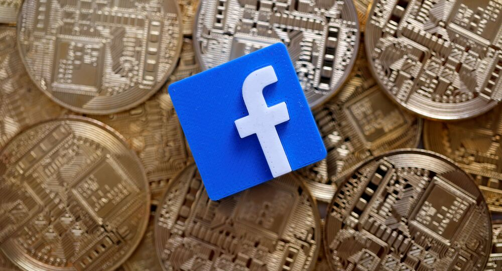 A 3-D printed Facebook logo is seen on representations of the Bitcoin virtual currency in this illustration picture, June 18, 2019