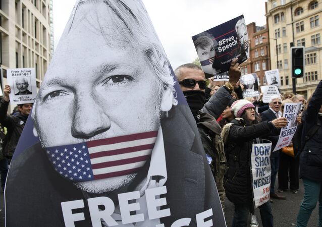 Supporters of WikiLeaks founder Julian Assange block the traffic on Marylebone Road to protest against the extradition hearing of Julian Assange at Westminster Magistrates Court, in London. File photo