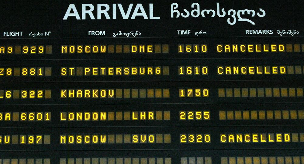 A view of an arrival-departure board with flights to Russia canceled seen at Tbilisi International airport