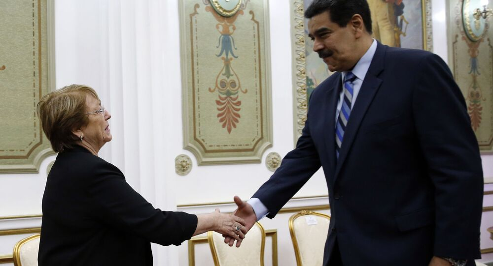 U.N. High Commissioner for Human Rights Michelle Bachelet, left, is greeted by Venezuela's President Nicolas Maduro