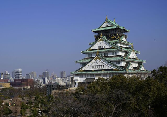 The main tower of Osaka Castle rises above the city in Osaka, Japan.