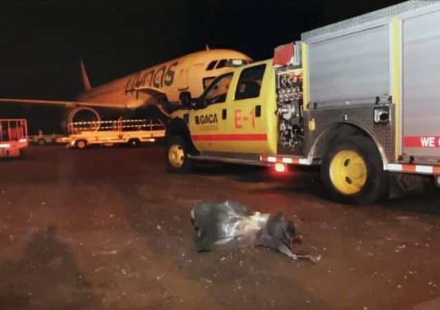 This photograph released by the state-run Saudi Press Agency shows debris on the tarmac of Abha Regional Airport after an attack by Yemen's Houthi rebels in Abha, Saudi Arabia