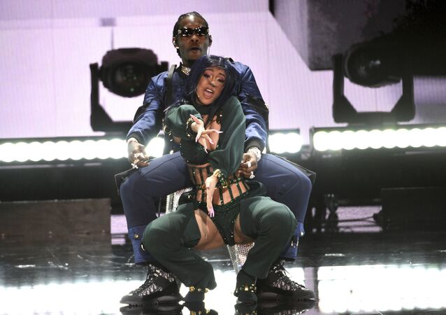Cardi B, foreground, and Offset perform at the BET Awards on 23 June 2019, at the Microsoft Theater in Los Angeles.