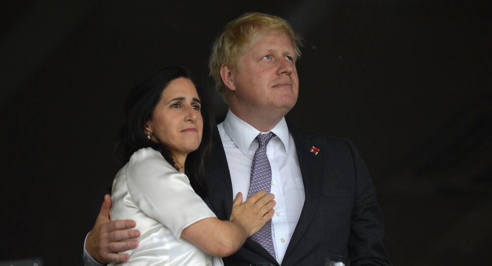 London's Mayor Boris Johnson (R) waits with his wife Marina Wheeler (L) prior to the start of the opening ceremony of the London 2012 Olympic Games on July 27, 2012 at the Olympic Stadium in London.