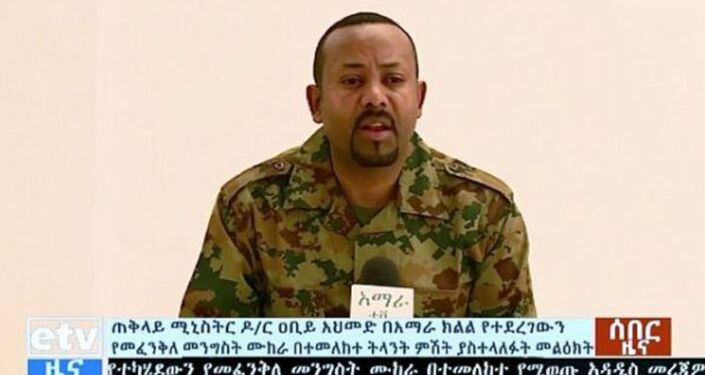 Ethiopia's Prime Minister Abiy Ahmed, wearing an army uniform, addresses the public on 23 June 2019 after a failed coup